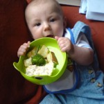 Look! Solid food! BabyUrban is a little too excited by the concept and forgets to eat