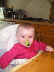 Another baby not taking the broccoli tree 'handle' very seriously...