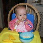 Little E is rather handy with her porridge spoons...